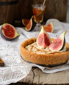 homemade tart with fresh figs on a vintage tablecloth