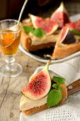piece Tart with caramel cream and fresh figs served on a linen napkin