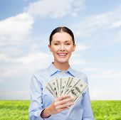 business and money concept - young businesswoman with dollar cash money