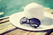 beach, summer, vacations and accessories concept - close up of beach accessories at seaside