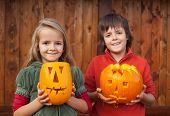 Kids with freshly carved Halloween pumpkin jack-o-lanterns