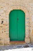 Wooden door. Rocca Imperiale. Calabria. Italy. poster