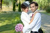 Wedding shot of bride and groom in park.