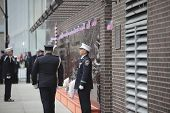 FDNY honor guard by memorial wall