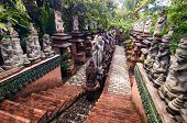 Stairs In A Sacred Park With Numerous Religious Statues Of Gods And Spirits In Tropics