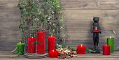 Christmas Decoration With Red Candles, Birdcage And Pine Branches