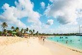 People Relaxing On Sunset Beach Of St Maarten, Caribbean Island
