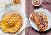 Pumpkin Crepes With Fruit Confiture And Chocolate Cream