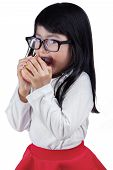 pic of indian apple  - Beautiful little girl wearing glasses and eating a red apple in the studio isolated on white background - JPG