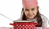 picture of ladle  - girl pretending to cook in a pot with ladle - JPG