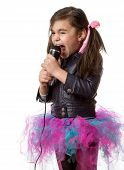 picture of singing  - young little girl with microphone singing on white background - JPG