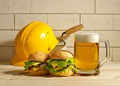 Beer And Burgers With The Helmet Against A Brick Wall