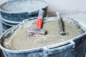 stock photo of mason  - yard work at home with the tools of the masons - JPG