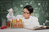 Little Scientist Doing Experiment