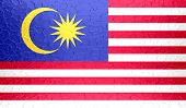 Malaysia flag on metallic metal texture