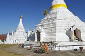 Buddhist monks clean territory of the Wat Phra That Doi Kong Mu temple in Mae H