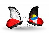 Two Butterflies With Flags On Wings As Symbol Of Relations Poland And Antigua And Barbuda