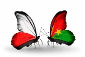 Two Butterflies With Flags On Wings As Symbol Of Relations Poland And Burkina Faso