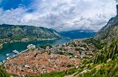 The Kotor Bay, Old City Roofs And Port. Adriatic Sea Beach And Mountain. Fisheye Lens Top View