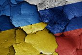 picture of civil war flags  - flags of Ukraine and Russia painted on cracked wall - JPG