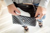 foto of tampon  - Closeup photo of young woman putting menstrual pad out of handbag - JPG
