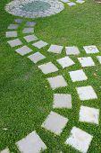 Cement Stone Pathway In Green Grass Garden