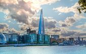 Shard of glass on river Thames. Modern London architecture