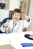 Happy Very Young Doctor Thumb Up In Office