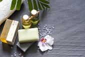 picture of personal care  - Cosmetics for body care and spa abstract still life on black stone - JPG
