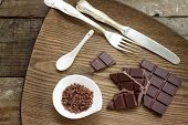 Chocolate Bar With Chocolate Chips And Silverware