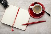 stock photo of coffee-cup  - opened blank notebook cup of espresso red ball - JPG