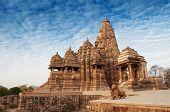 stock photo of kandariya mahadeva temple  - Kandariya Mahadeva Temple dedicated to Shiva Western Temples of Khajuraho under cloudy sky Madya Pradesh India - JPG