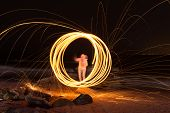 stock photo of slag  - Showers of hot glowing sparks from spinning steel wool at Coney Island Beach Brooklyn New York - JPG
