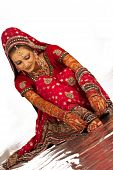 picture of indian wedding  - Beautiful Bangali bride in colorful dress sitting isolated - JPG