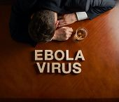 Phrase Ebola Virus and devastated man composition