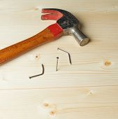 Hammer and nails over the wooden boards