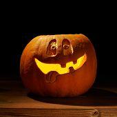 Happy jack o lantern pumpkin composition