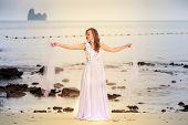 Bride Whirls On Sandy Beach