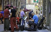 Volterra, Tuscany, street musicians. Color image