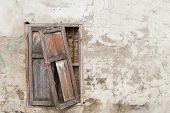 Broken Old Window On Old Cracked Wall