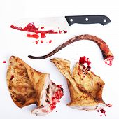 pork ears with knife and blood white background.
