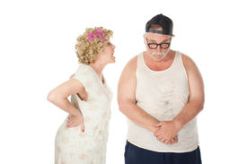 foto of wife-beater  - Bickering wife yelling at a shamed husband - JPG