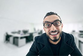 foto of crappie  - Funny Businessman with crazy expression Lazy Businessman making funny expressions at work - JPG