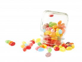 picture of jar jelly  - Colorful jelly bean candy sweets spilled out of a glass jar - JPG