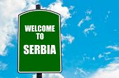 foto of serbia  - Green road sign with greeting message WELCOME TO SERBIA isolated over clear blue sky background with available copy space - JPG