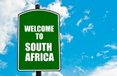 picture of south-pole  - Green road sign with greeting message WELCOME TO SOUTH AFRICA isolated over clear blue sky background with available copy space - JPG