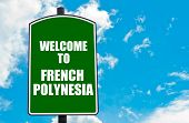 stock photo of french polynesia  - Green road sign with greeting message Welcome to FRENCH POLYNESIA isolated over clear blue sky background with available copy space - JPG
