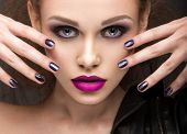 stock photo of nail-design  - Beautiful girl in leather jacket with bright makeup and manicure Cat - JPG