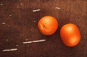 image of bittersweet  - Fresh Ripe Tropical Sweet Orange Fruit on Rustic Grunge Brown Wood Background Top View - JPG