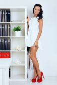 foto of provocative  - sexy provocative businesswoman in white dress at office - JPG
